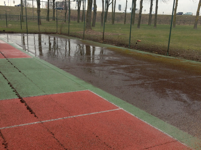 reinigen tennisbaan